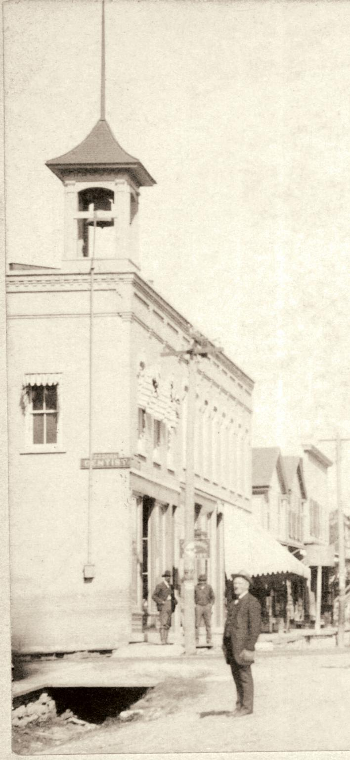 Reuss Building with bell in downtown Naperville, late nineteenth century