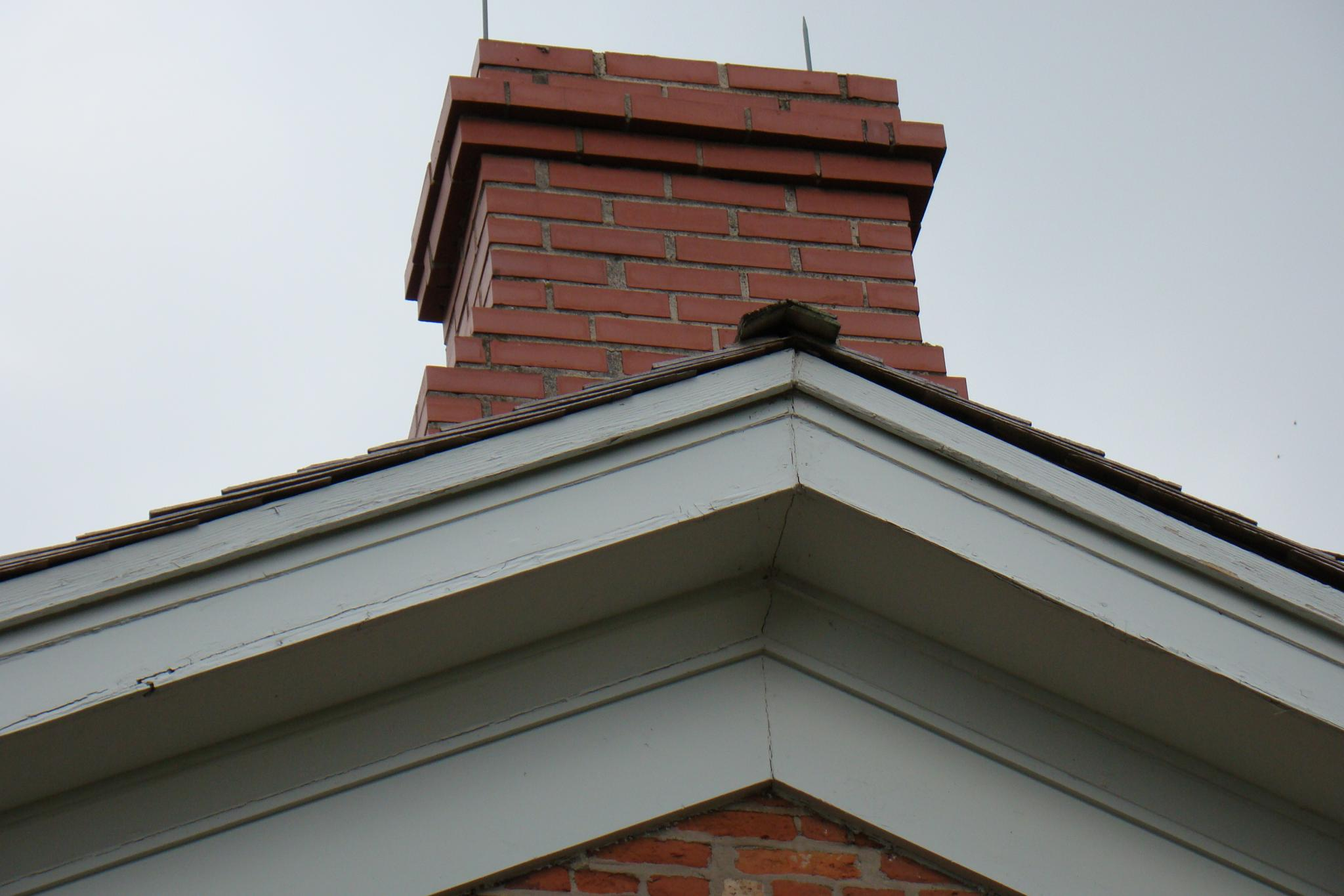 Wide trim on gable end of Halfway House