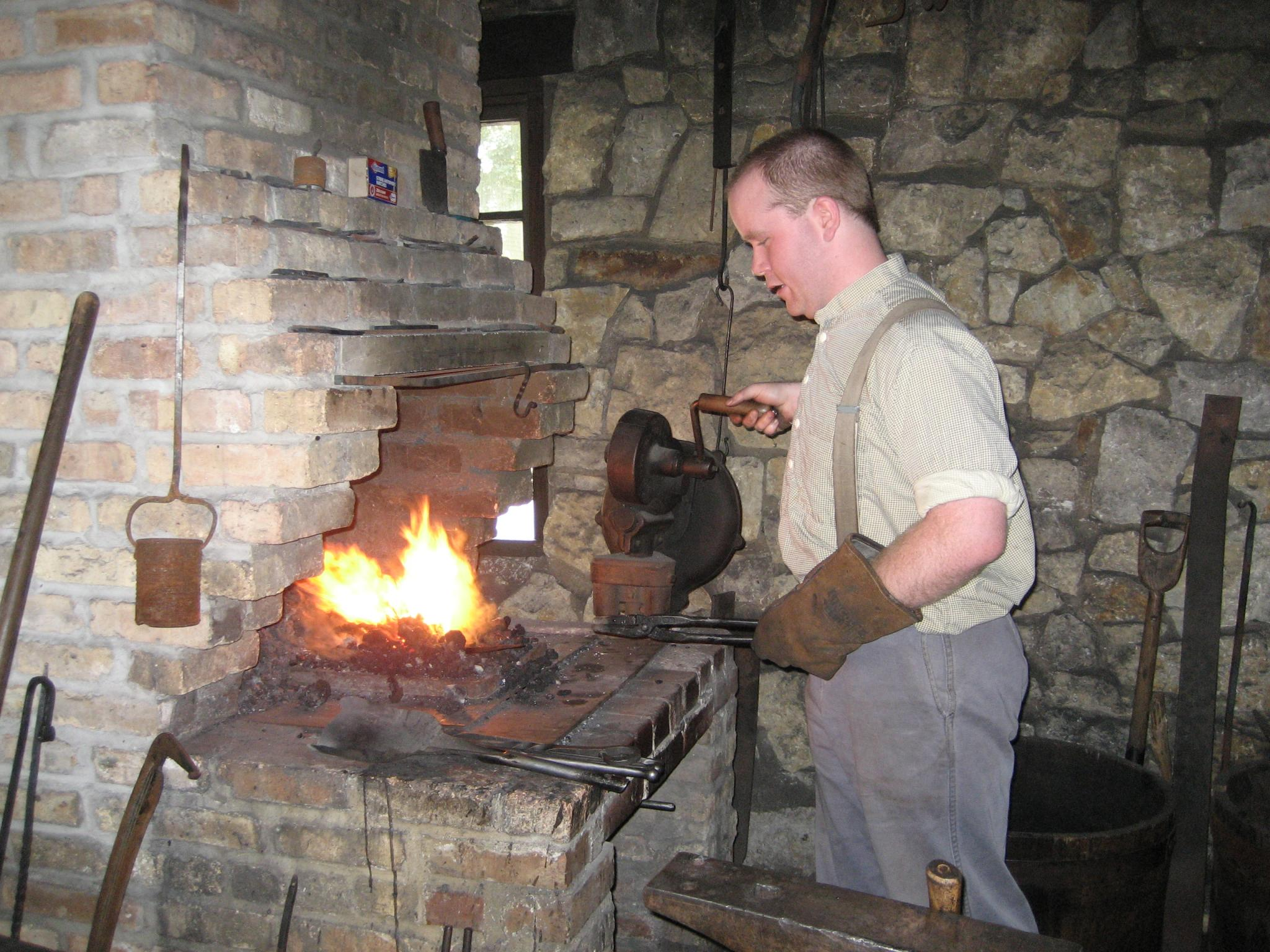 Blacksmith using forge in Blacksmith Shop