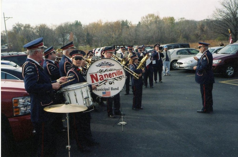 Photograph of musical band preparing to play